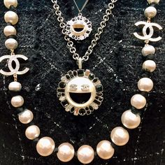 """Shopping for souvenirs at Chanel's shop on Avenue Montaigne. I loved the <a href=""""http://www.chanel.com/en_US/fashion/products/costume-jewelry/g/s.necklace-metal-resin-strass-silver-.16K.A96314Y50581Z5187.c.16K.html"""" target=""""_blank"""">pearl-and-crystal emoji necklaces</a> and pins."""