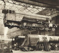 BW photograph from 1935, vintage steam train engine, train workshop, the Pacific train engine, train construction. $21.95, via Etsy.