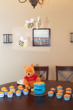 Homemade cupcakes and cakes for Winnie the pooh themed birthday. Hunny smash cake and cupcakes