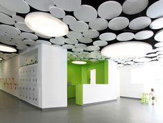 modern daycare in france. what a sweet ceiling design