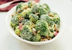 The BEST vegan broccoli raisin salad made with a rich and creamy cashew dressing instead of mayo.   eatingbirdfood.com