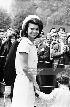 Jacqueline Kennedy (1929 - 1994) attends the inauguration of a memorial to her husband John F. Kennedy in Runnymede, Surrey, nearly eighteen months after his assassination. Holding her hand is her young son, John F. Kennedy Jr. (1960 - 1999).