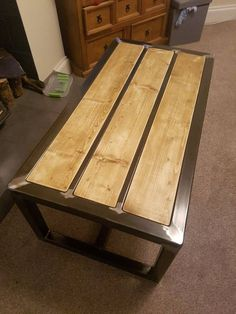 Steel and wood coffee table is part of Coffee table wood A beautiful hand made coffee table Made with 50 x 50 mild steel box section with rustic designed wooden planks with a Matt varnish finish -