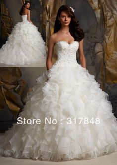 Lovely ruffle wedding dress. a bit over the top  but i like it