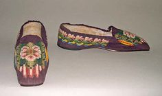 Slippers Date: mid-19th century Culture: American Medium: silk, leather Dimensions: 2 1/2 x 10 in. (6.35 x 25.4 cm) Credit Line: Bequest of Maria P. James, 1910 Accession Number: 11.60.200a, b