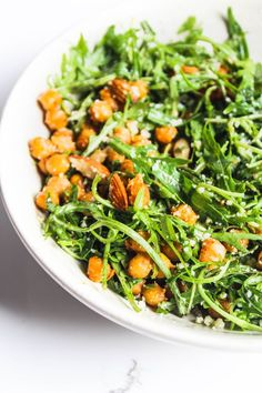 Arugula chickpea salad with almonds and Parmesan and the easiest olive oil, honey and lemon dressing #salad #arugula #arugulasalad #chickpea #chickpeasalad #almonds #fresh #easy #dinner