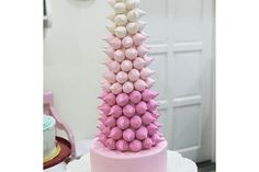 Meringue Tower of Kisses - Finally! A class that combines 2 of the current best loved trends: Meringues and Fondant! In this hands-on workshop, we will demystify the workings of egg whites and teach you how to get perfectly crisp meringue kisses, flavoured with natural and organic fruit! No artificial intruders here! No no! (LessonsGoWhere.com.sg)