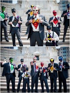 Groomsmen superhero shirts under tuxedos very cute