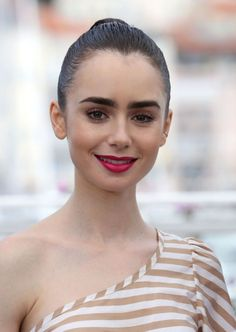"""Lily Collins at the """"Okja"""" screening during the 70th annual Cannes Film Festival at Palais des Festivals on May 19, 2017 in Cannes, France. #cannes #festivaldecannes #cannes2017 #cannesfilmfestival #redcarpet #celebrity #fabfashionfix"""