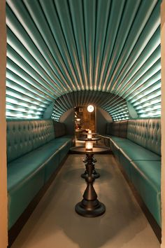 Wouldn't mind a tipple amidst the turquoise in this London bar: dirty martini / grapes design