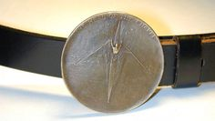 Head of Charles Regatta fist place medal converted to a belt buckle. It beats leaving it in a drawer! Cost is $50 for conversion, plus belt.