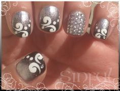 Grey nails with swirls