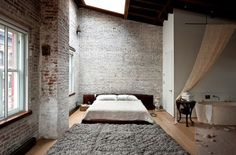 Roof-top loft with roof window 3 to 5 mtr walls, industrial brick walls. Open bath tub