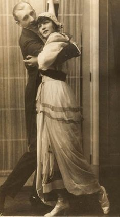 As I am very interested in looking at dance fashion throughout the years, here are the highlights of ragtime dancing costumes: Freed from the restriction of tight corsets, large puffed sleeves and long skirts, dancers were swaying, hugging, and grinding to the new rhythms in dance. The hobble skirts restricted movement but dance frocks often featured a split skirt to allow movement. Men wore formal black tailcoat with white bow tie, wingtip collar and white vest.