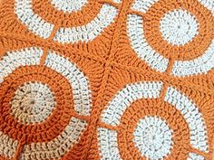 Graphic Circles Throw Crochet Pattern by Julie Yeager. Love the center squares created by the secondary color and post stitches.