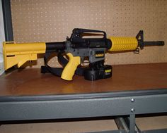 YEAH BABY!!!! A Dewalt-M16 Nail Gun! Great idea for the tool man!