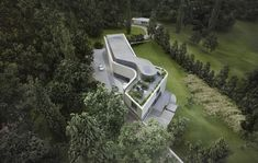 Contemporary architecture, eco concrete house designed by Burrell Architects. Western aerial view - encompassing a roof garden and skyroom inspired by the artist James Turrell.