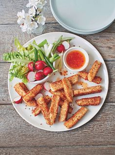 Halloumi dippers with sweet chilli sauce. Try this fun way of serving halloumi by coating in sesame seeds and frying. Find the recipe in issue 25