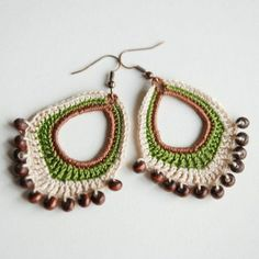 Crochet boho beaded dangle earrings made with cotton floss and wooden beads by Shepit on Etsyi bet you could make these ridiculously enormousI crocheted these earrings with cotton floss. They are about long (without the hooks). Will look wonderful wi Crochet Jewelry Patterns, Crochet Earrings Pattern, Bead Crochet, Crochet Accessories, Crochet Designs, Crochet Necklace, Beaded Earrings, Beaded Jewelry, Handmade Jewelry