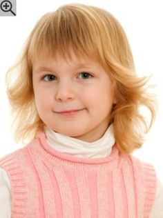 A kids hairstyle that is parent friendly. Almost shoulder length hair with smooth bangs.