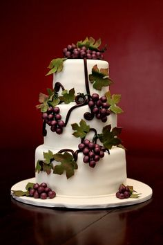 Of all the fake grapes/leaves I saw, this was the best.  I think I'd like it better with a navy blue ribbon around the base of the tiers, though.