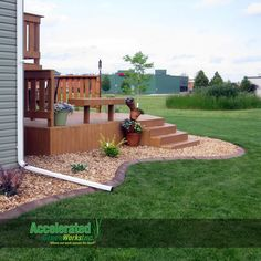 Concrete curb edging blends an existing lawn with a deck platform, Bryan red landscaping rock and annual pots. Hundreds of colors and stamps available to customize your installation!