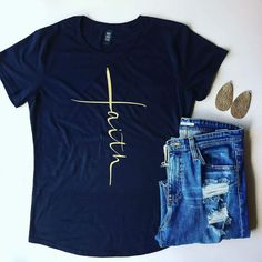 Faith Blue T-Shirt for Women This beautiful t-shirt is perfect for women who want to wear their faith proudly. Faith is spelled out vertically in gold again a perfect shade of dark blue.