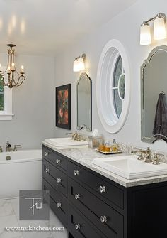 Transitional master bathroom: Grabill Cabinets Inset Madison Square Maple Black bathroom vanity cabinets. J. Peterson Homes, Dixon Interior Design LLC, Ashily Avila Photography