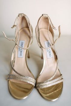 """Say """"I Do"""" in one of the most elegant pair of heels. These gold strappy sandals make the perfect addition to your city-chic wedding.   Chicago Wedding Sparkles at the Waldorf Astoria. #IDoinJimmyChoo"""