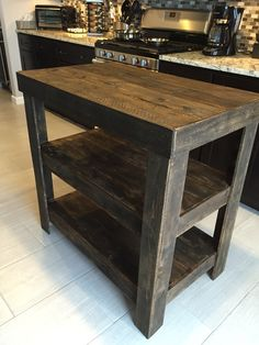 Kitchen Island made from Pallet wood Could make this to put out water or additives for the coffee. Ie. cinnamon, flavorings... could move people away from the counter and line free up space and keep people moving.