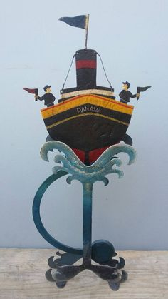 Check out this item in my Etsy shop https://www.etsy.com/uk/listing/488211009/folk-art-metal-panama-ship-balance-toy