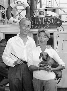 Jacques Cousteau and his first wife, Simone Cousteau, aboard their boat, Calypso. It's amazing to think of the wonderful and mysterious things that his dachshunds, which included red smooths 'Bulle' and 'Scaphandrier,' must have experienced in their travels with their beloved human. This photo is from 1959.
