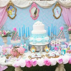 Beautiful Cinderella dessert table at a Cinderella girl birthday party! Check out that lovely cake, princess cupcakes, and macaron towers! | CatchMyParty.com
