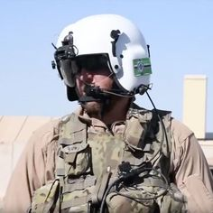 A civilian contractor working with the U.S. armed forces in Afghanistan for MAG Aerospace pictured in 2018 wearing a Kekistan flag patch on his helmet. KEK is a central symbol in the Alt-Right internet culture and online white nationalism. Bush Jr, Diy Couch, Military News, Pop Culture References, Sacramento California, Confederate Flag, Flag Patches, Islamic World, Knights Templar