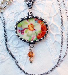 Broken China Jewelry, Pendant Necklace, Burnt Orange Floral Chintz, Sterling Silver Necklace by Robinsnestcreation1 on Etsy https://www.etsy.com/listing/166459291/broken-china-jewelry-pendant-necklace
