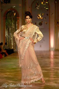 Shirt style blouse must keep in mind.the buckled belt is new as well.. Neeta Lulla sheer saree with shirt-style satin blouse