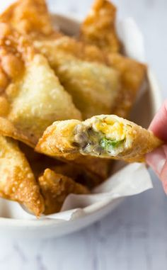 Sausage and Cheese Wontons. Crunchy wontons that are filled with savory sausage and a two-cheese combo then fried to perfection and served with dipping sauce. Wonton Appetizers, Wonton Recipes, Egg Roll Recipes, Milk Recipes, Yummy Appetizers, Appetizer Recipes, Cooking Recipes, Sausage Appetizers, Party Appetizers