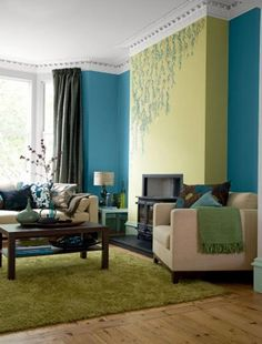Blue and green living room ideas... check out the chocolate brown in that pillow!