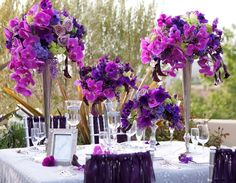 Purple orchids - wedding reception table decorations
