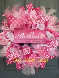 """This wreath is for all of the breast cancer survivors and fighters. Read on for additional details.  This wreath...  -Features 6 different types of deco mesh in pinks and whites in a """"curly"""" style.  -Also features pink and white polka dotted and chevron ribbon.  -Also features light pink ..."""