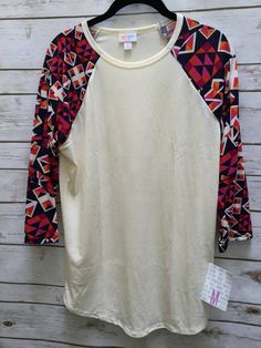 This beautiful Lularoe Piece would make a wonderful addition to your Lularoe collection. Join our group and shop all our Lularoe styles and sizes. https://www.facebook.com/groups/peaceloveandlularoe/