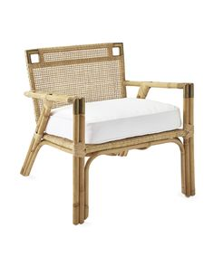 We love this chair for its simplicity and restraint. Crafted of natural rattan with brass accents that add an air of refinement, it's the perfect blend of polished and relaxed. A slim silhouette makes it great for smaller spaces, and the cozy cushion lets you liven things up with color and pattern.
