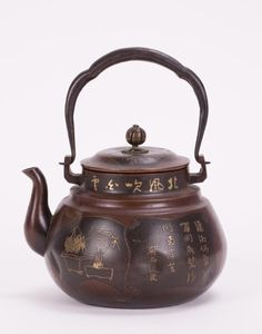 JAPANESE MIX METAL TEAPOT - 19th century; 4 1/2 in. h, 5 3/4 in. w