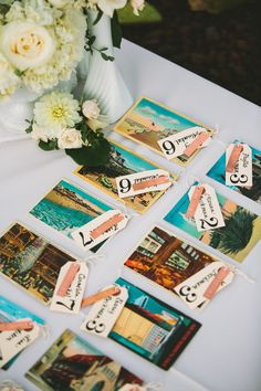 Escort cards: Jamie created escort cards with vintage postcards and shipping tags, and stamps from Etsy, and her friend Celia handwrote all the names. All the postcards were personalized for each guest too, which was a huge hit and conversation starter!