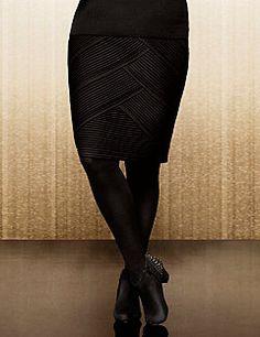 94272152b9 Figure-flattering diagonal pleats define modern femininity on this stunning  skirt from the Lane Collection