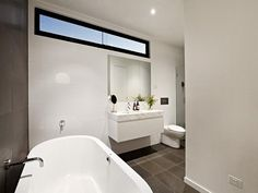 Awesome Robert Simeoni Building of Natural Modern House: Fascinating Contemporary Melbourne Home Bathroom Interior Design In Bold White Furn. Small Bathroom Window, Bathroom Windows, Large Bathrooms, Modern Bathroom, Downstairs Bathroom, Mirror Bathroom, Master Bathroom, Bathroom Ideas, Flat Roof House