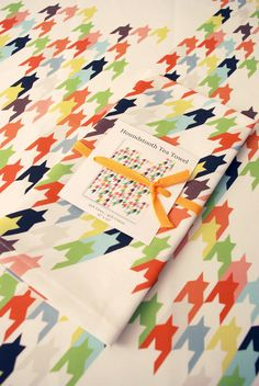 Love the kitchen textiles of Avril Loreti. From the houndstooth tea towels to the paint chip placemats, her pieces are a great way to add a splash of color – and fun – to your table.