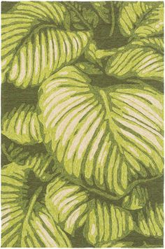 a sense of the tropics is created with this tropical forest green area rug from the