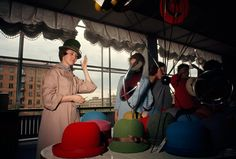 Women try on hats in a variety of colors in Moscow, March 1966