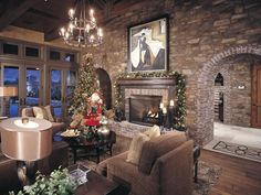 Rusic yet traditional living room with stone wall and brick archways, displaying a christmas tree, garland, and wood fireplace.
